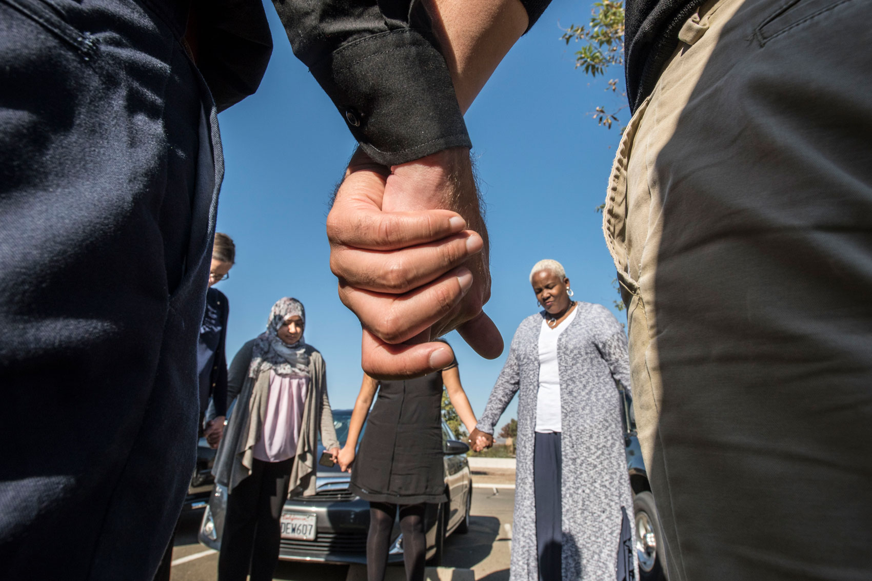 Faith In The Valley Leaders Holding Hands During An Action. (Photo By Bryan Patrick)