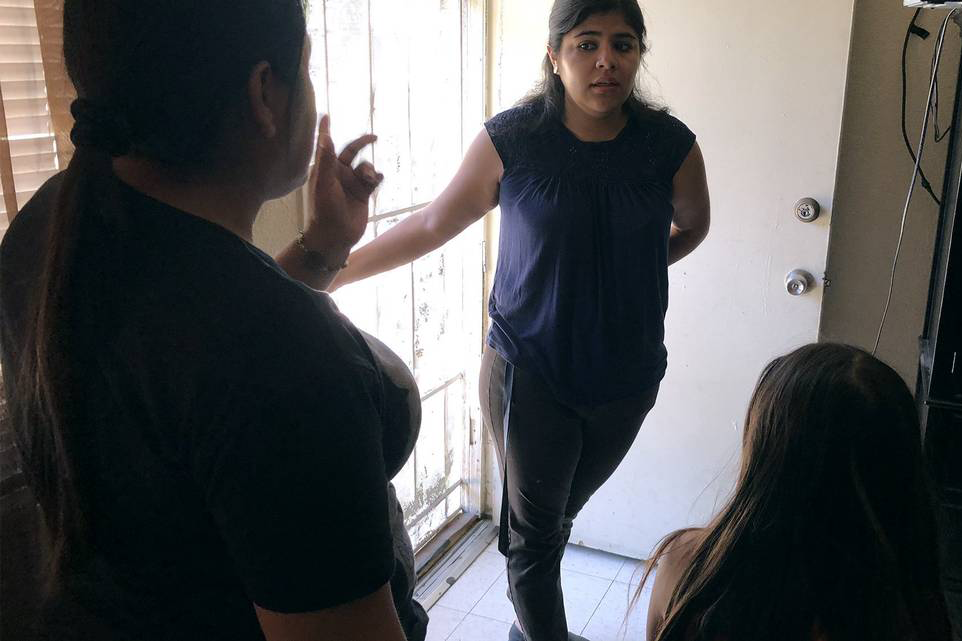 Kim Martinez, A Community Organizer With Faith In Stanislaus Speaks With Tenants In A Rental Apartment About Their Concerns In Fresno. (Photo By Joan Barnett Lee)