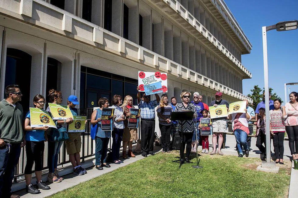 Residents hold a rally calling for an end to the separation of immigrant children and parents who are detained by the U.S. Immigration and Customs Enforcement agency, outside the Merced County Administration Building. (Photo by Andrew Kuhn)